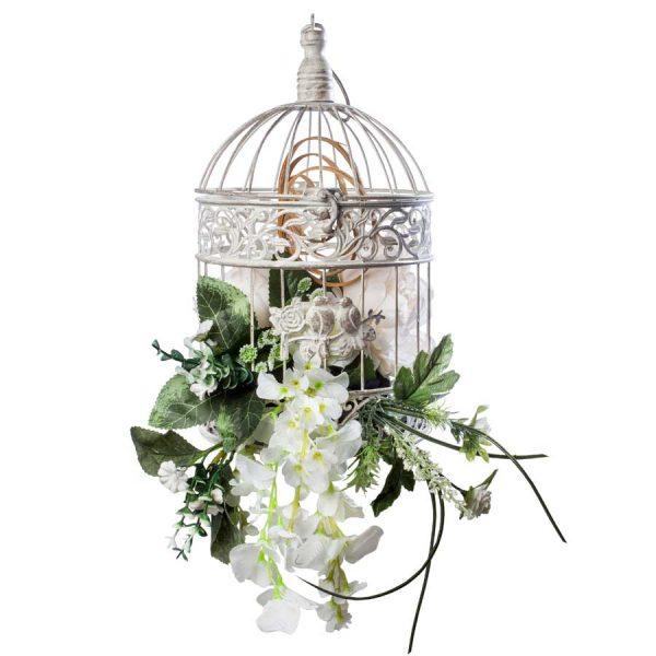 Jaula decorada con flor artificial y seca